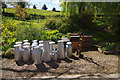 SO7679 : Milk churns at Arley by Stephen McKay