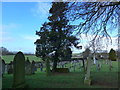 NY3250 : St Andrew, Thursby: churchyard (e) by Basher Eyre