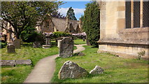 SP0228 : St Peter's churchyard in May by Roger Davies