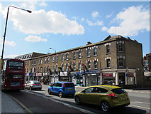 TQ3978 : Shops on Woolwich Road by Stephen Craven