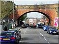 SU9950 : Railway Bridge over Woodbridge Road by David Dixon