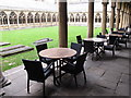 SK9771 : Lincoln cathedral cloisters with cafe tables by David Hawgood