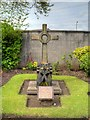 SJ4893 : Cross in Church Garden by David Dixon