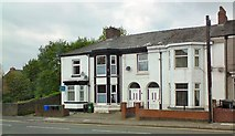 SJ9499 : Houses on Mossley Road by Gerald England