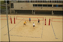TQ3470 : View of men playing a beach volleyball match at the National Sports Centre by Robert Lamb