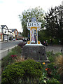 TM1179 : Diss Town sign by Adrian Cable