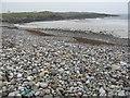 NL9344 : Stony beach at Greenhill by M J Richardson