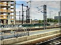 TQ2983 : HS1 passing King's Cross Gasholder Number 8 by David Dixon