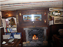 NX4355 : The fireplace, Wigtown Ploughman Hotel by Oliver Dixon