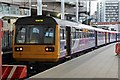 SJ8499 : Northern Rail Class 142, 142003, platform 2, Manchester Victoria railway station by El Pollock