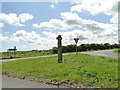 TG2134 : The cross at Hanworth crossroads by Adrian S Pye