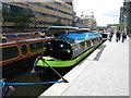 TQ2681 : Merchant Square canoe & paddleboat hire - narrowboat in Paddington Basin by David Hawgood