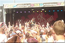 TQ1985 : View of a sea of hands in the air at the Colour Run #2 by Robert Lamb