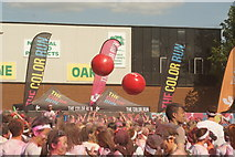 TQ1985 : View of two giant volleyballs in the crowd at the Colour Run by Robert Lamb