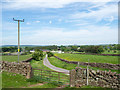 NY6136 : Gate in dry stone wall by Trevor Littlewood