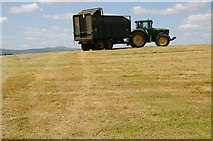 SO8843 : Tractor and silage trailer by Philip Halling