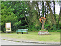 TM1598 : Information board, seat and village sign, Wreningham by Adrian S Pye