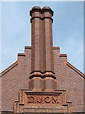 NZ2564 : Chimneys and inscribed stone, Sutherland House, College Street, NE1 by Mike Quinn