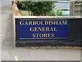 TM0081 : Garboldisham General Stores sign by Adrian Cable