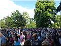 TF6928 : Crowd leaving the paddock near Sandringham church by Richard Humphrey