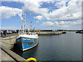 NU2232 : Fishing boat in Seahouses harbour by Robert Graham