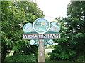 TF8522 : Weasenham village sign (detail) by Adrian S Pye