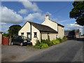NY6627 : Roadside cottage at Slakes Farm by Oliver Dixon