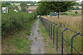 TQ0648 : Footway by the A248 by Alan Hunt