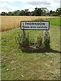 TM1469 : Thorndon Village Name sign on Rishangles Road by Geographer