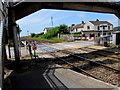 SN3610 : Barriers down across Ferryside railway station level crossing by Jaggery