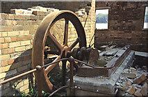 SH4094 : Porth Wen Brick Works - remains of steam engine by Chris Allen
