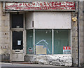 NJ2370 : An old shop front at Lossiemouth by Walter Baxter