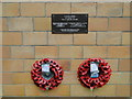 TF5906 : WW2 Memorial on the outside wall of Stowbridge church by Adrian S Pye