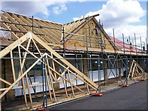 TF0920 : Roof repairs at the Darby and Joan Hall, Bourne, Lincolnshire by Rex Needle