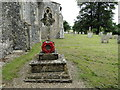 TG2129 : Banningham war memorial in the churchyard by Adrian S Pye