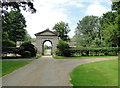 TG2233 : The west gate at Gunton Park Estate by Adrian S Pye