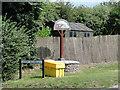 TG2738 : Trimingham village sign and yellow sandbin by Adrian S Pye