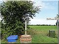 TG3431 : Ridlington village sign by Adrian S Pye