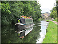 SE2335 : Canal boat at Rodley by Stephen Craven