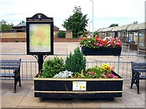 TF0920 : Floral welcome at Bourne bus station, Lincolnshire by Rex Needle