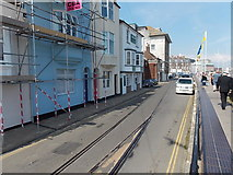 SY6878 : Disused railway track in the middle of the Custom House Quay roadway, Weymouth by Jaggery