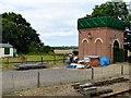 TG0939 : Brick Water Tower at Holt Station by David Dixon