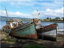 NM5643 : Decaying fishing boats alongside jetty at Salen by David Martin