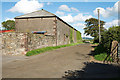 NY2039 : Barn at east end of Torpenhow by Trevor Littlewood