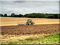 TF8008 : Tractor in Field near Swaffham by David Dixon