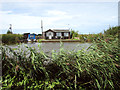 TG4319 : Bungalow beside the River Thurne by Evelyn Simak