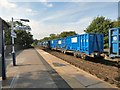 SJ9494 : Trucks of recycled waste passing through Hyde Central station by Gerald England