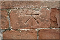 NY6819 : Benchmark on St Michael's Church by Roger Templeman
