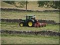 SD9078 : Tedding grass at Yockenthwaite by Graham Robson
