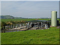 NY0786 : Cattle pens and silo at Cumrue Farm by Oliver Dixon